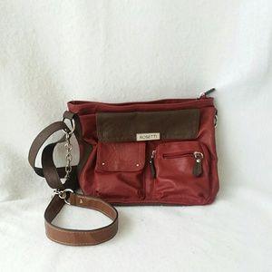 Rosetti multi pocketed hand bag purse